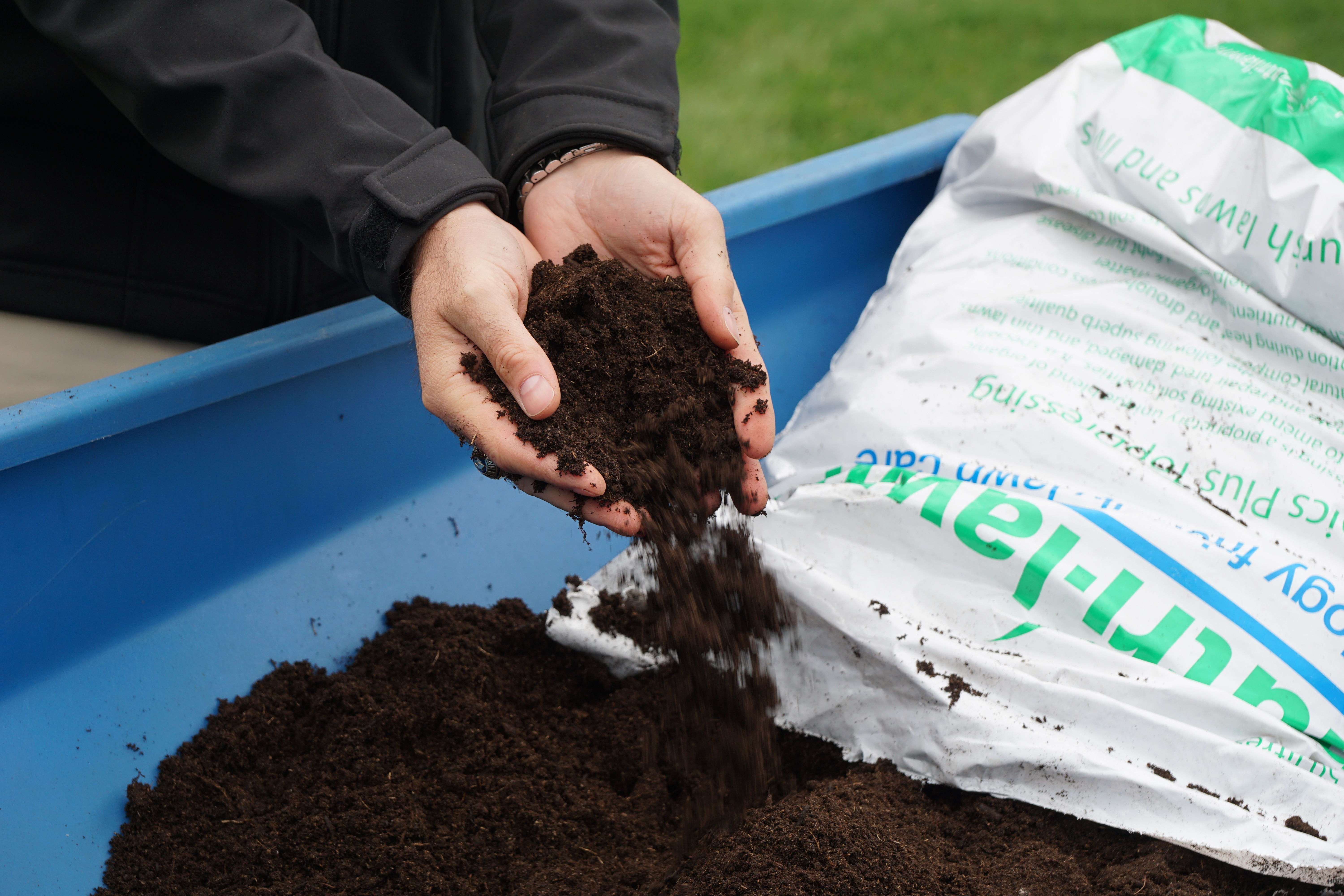 nutrilawn-top-dressing-pouring-from-hands.jpg